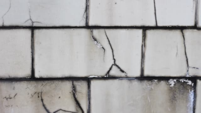 old white brick wall with cracks.split pattern block