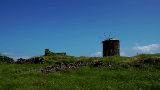 Old windmill with pasture