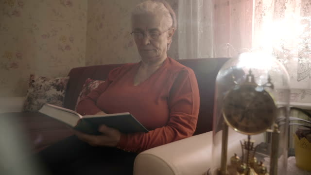 Old woman is reading book