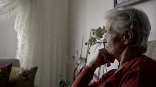 old woman is thougthful and looks at the camera - care home stock videos & royalty-free footage