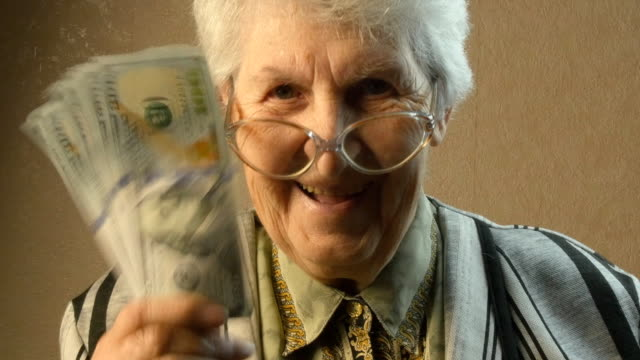 Old woman rejoices money video
