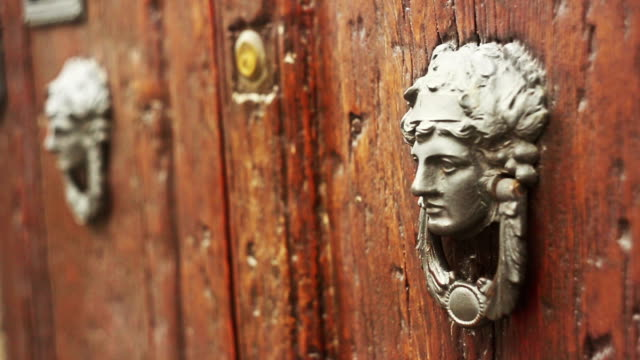 Old woman shaped door knocker video