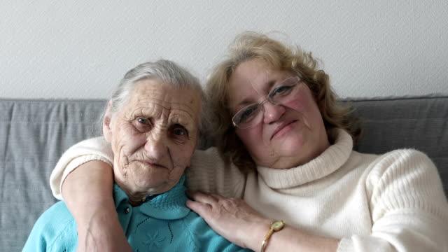 old women portrait with happy mom and daughter hugging. - kołdra filmów i materiałów b-roll
