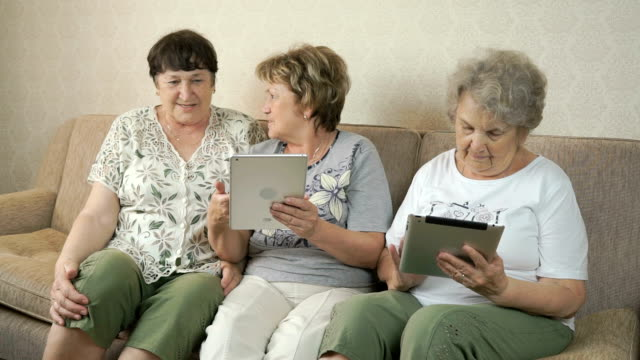 Old women talking with each other at home video