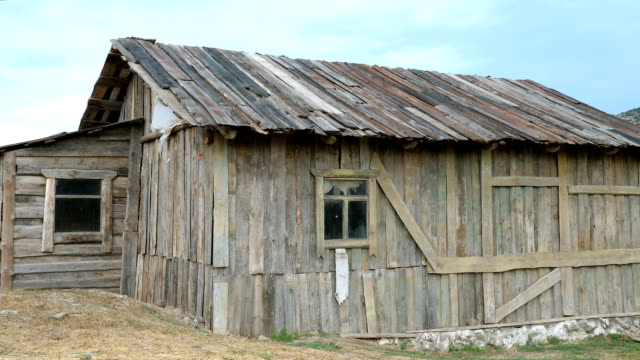 Old wooden barn. Old wooden barn with windows. barns stock videos & royalty-free footage