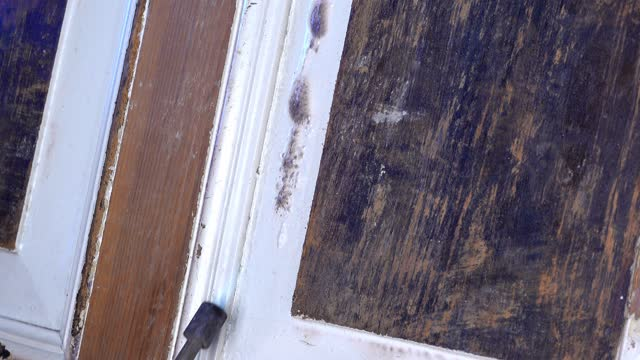 Old Wooden Door Renovation Using Gas Fuelled Blowtorch To Remove Paint Close Up