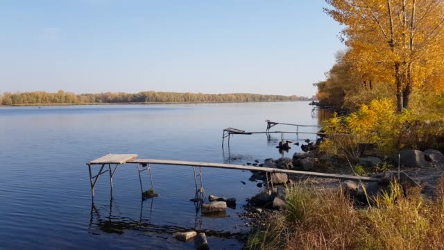 Old wooden fishing platform on the river. video