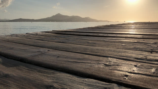 gamla träpiren, mallorca soluppgång - solar panel bildbanksvideor och videomaterial från bakom kulisserna