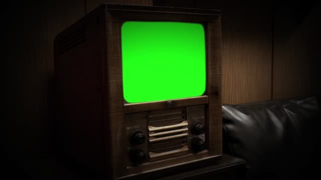 old wooden tv with green screen. - obsoleto video stock e b–roll