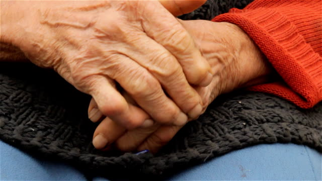 Old wrinkled farmers hands video