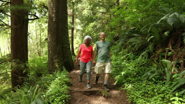 SLO MO Older couple going on a hike in the woods video