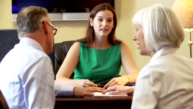 Older Couple Talking To Financial Advisor In Office video