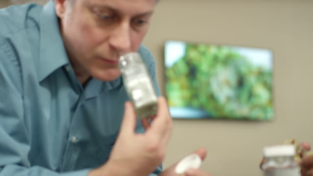 Older customer at marijuana shop smelling a product and smiling video