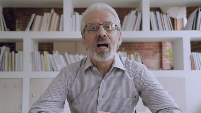 Video Older male skype teacher talking looking at webcam make call