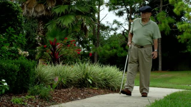 Older Man Walking With Injuries video