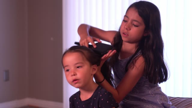 Older Sibling Duties A loving older sister getting her younger sister ready for the day. sister stock videos & royalty-free footage