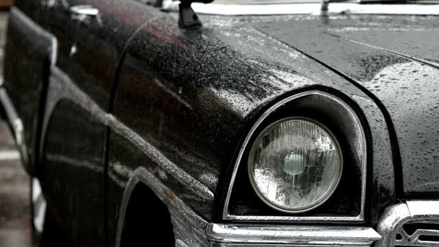 Old-fashioned car in the rain