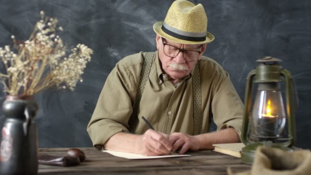 Old-Fashioned Elderly Man Writing Letter