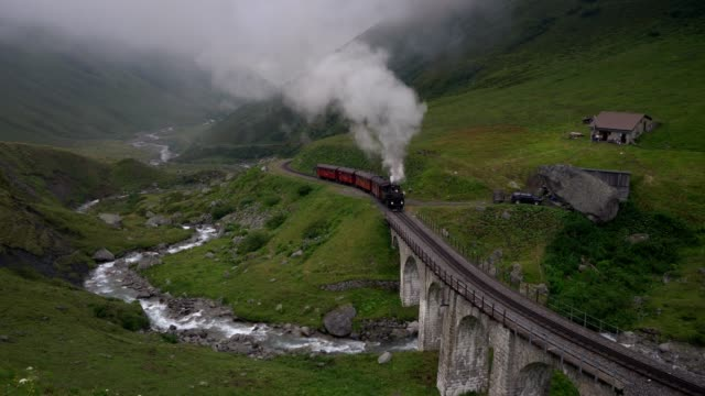 Old-fashioned steam train in Swiss Alps