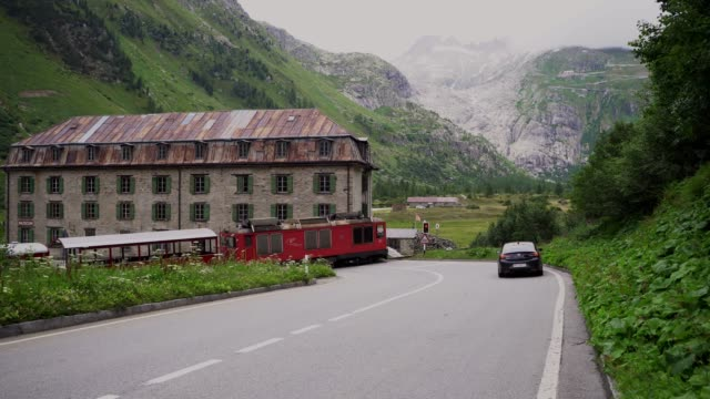 Old-fashioned steam train in village in  Swiss Alps