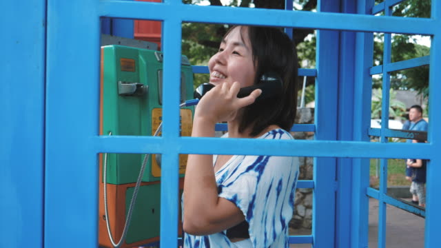 Old-fashioned telephone call, Typical blue telephone booth