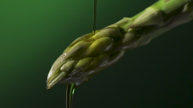 olive oil dropped on asparagus - video