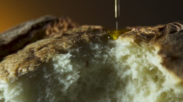 olive oil pouring on bread video