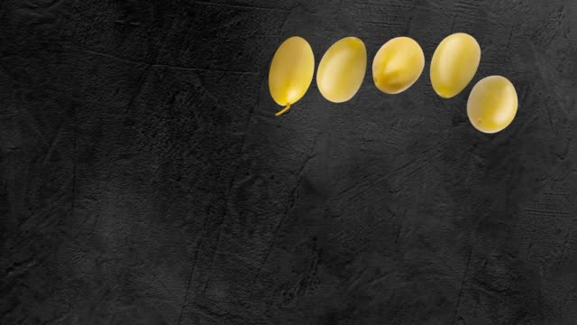 Olives animation on a black background with copyspace