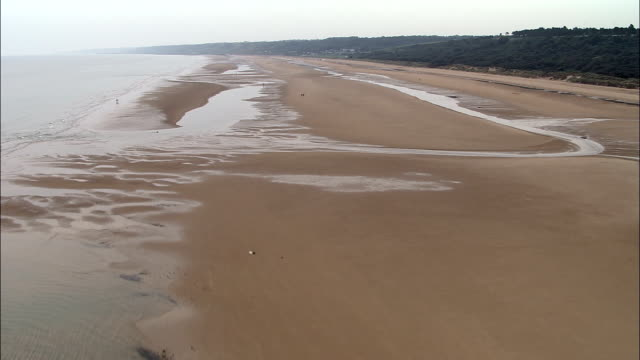 Omaha Beach  - Aerial View - Lower Normandy, Calvados, France Low over Omaha Beach going east,  birds flying past in f/g normandy stock videos & royalty-free footage