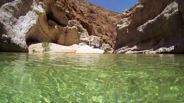 Oman, view inside a natural pool in Wadi Tiwi video