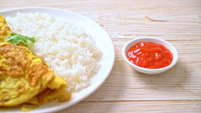 Omelet or Omelette with Rice and Ketchup