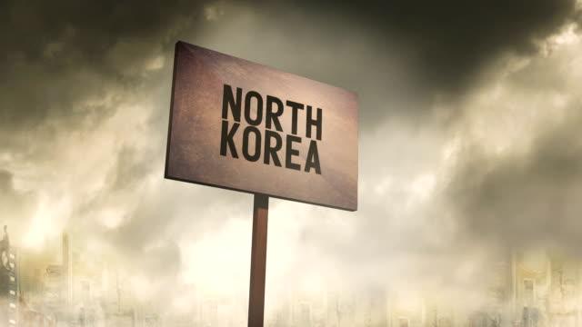 vidéos et rushes de rouillé augure sur fond de ville apocalyptique post - typographie de la corée du nord - nord