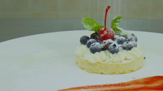 on a beautiful dessert strewed powdered sugar. - french food stock videos and b-roll footage