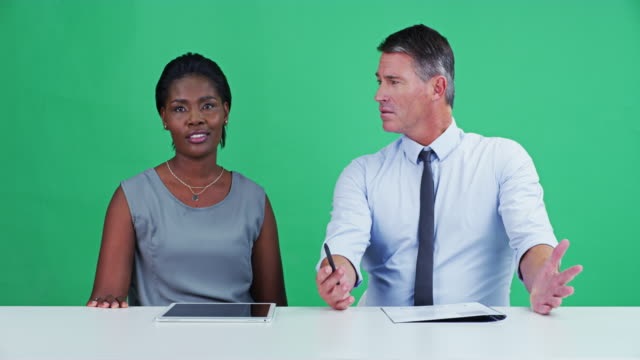 On a personal note Portrait of two confident news anchors reporting the news of the day inside of a studio with a green screen in the background television host stock videos & royalty-free footage