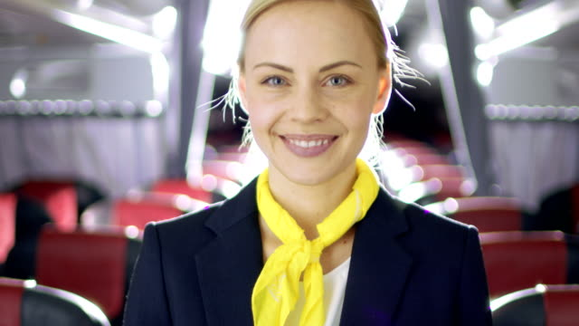 On a Plane Beautiful Blonde Stewardess/ Flight Attendant Smiles with Warm and Welcoming Smile. Airplane Looks New. video