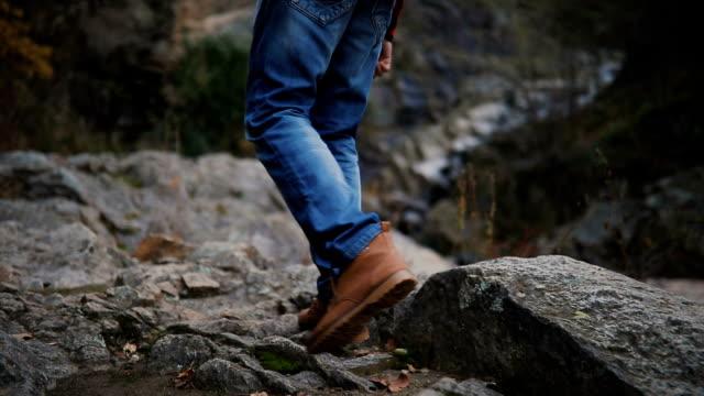 on a walk. hiker walking in a forest. - dżinsy filmów i materiałów b-roll