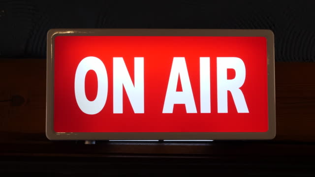 4k: on air sign switching on in studio - radio video stock e b–roll