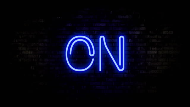 On Blue Neon Light on Brick Wall. Blinking Neon Sign. Motion Animation.