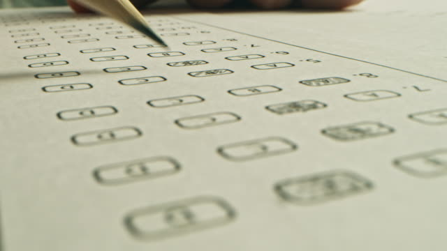 On Exam Test Person Colors Right Answers with a Pencil. Filling up Answer Sheet with Standardized Tests, Marking Correct Answer Bubbles On Exam Test Person Colors Right Answers with a Pencil. Filling up Answer Sheet with Standardized Tests, Marking Correct Answer Bubbles educational exam stock videos & royalty-free footage