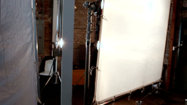 On Set Behind the scenes setting in photo studio. Lighting equipment set ups. photo shoot stock videos & royalty-free footage