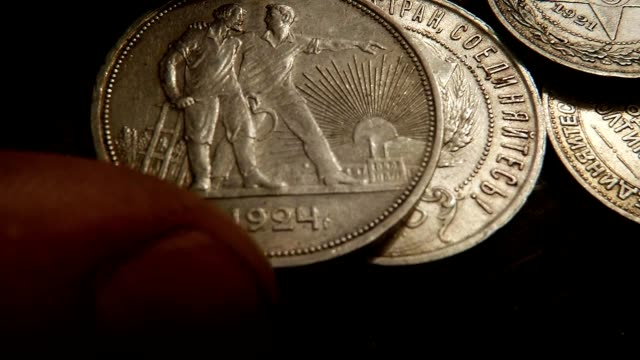 On Silver Coin with Sickle and Hammer Puts Money with Farmers on Obvers Macro video