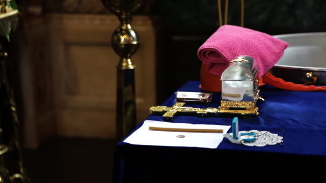 On table in church are prepared objects for rite of baptism video