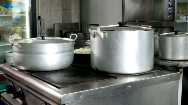 On the electric stove boil water in the saucepan for cooking video