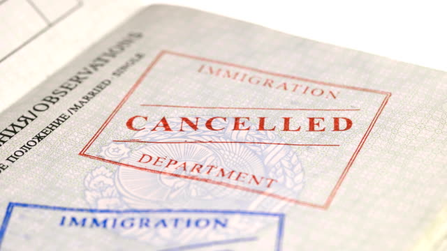 On the passport men put a stamp canceled On the passport men put a stamp canceled, close-up 4K schengen agreement stock videos & royalty-free footage