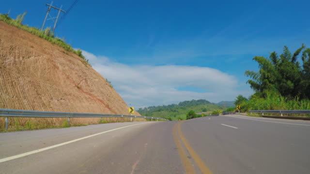 vídeos de stock, filmes e b-roll de sobre a estrada de khao kho distrito, tailândia - nordeste