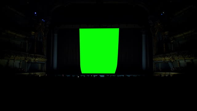 On the stage of the theater the curtain opens against a green background On the stage of the theater, the light goes out, the curtain opens against a green background, green screen, chroma key stage theater stock videos & royalty-free footage