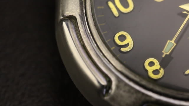 On the table are a wristwatch. Part of the dial is visible. The second hand moves. Close-up shot. On the table are a wristwatch. Part of the dial is visible. The second hand moves. Close-up shot. wristwatch stock videos & royalty-free footage