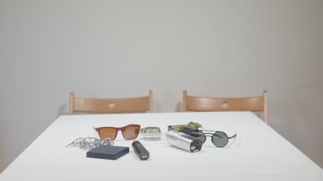 on the table are items of a modern marijuana smoker on the table are items of a modern marijuana smoker, vaporizer, eco-smoking hashish stock videos & royalty-free footage