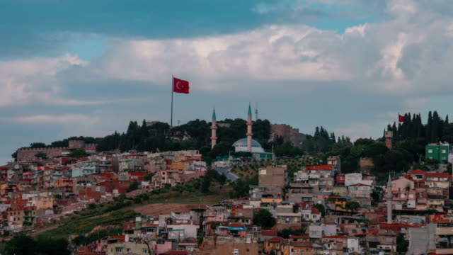 on the upper side of corrupt urbanization castle, kadifekale, izmir kadifekale,castle,flag, urban sprawl,izmir turkey stock videos & royalty-free footage