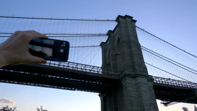 POV on Tourist Photographing Brooklyn Bridge in 4K Slow motion 60fps video